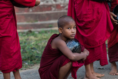 Young monk before collecting the morning rice offering from villagers