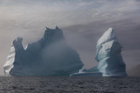 Iceberg with morning mist near Tasiilaq, Greenland